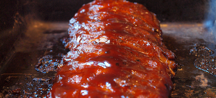 Pork ribs slathered in barbeque sauce