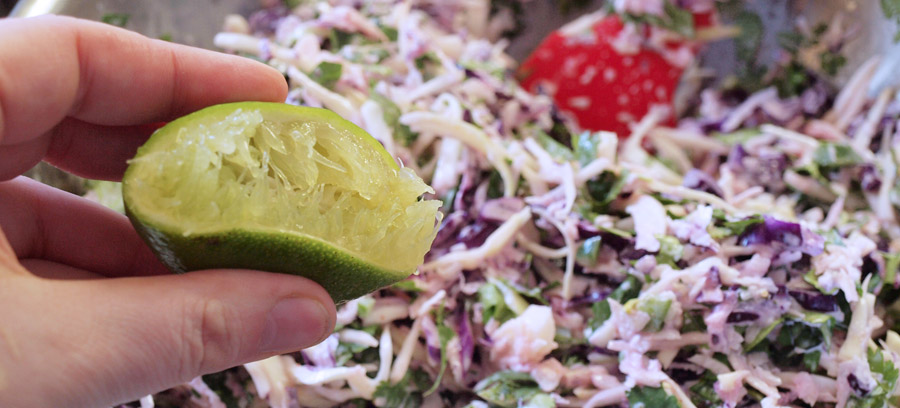 Squeezing the lime juice into the slaw