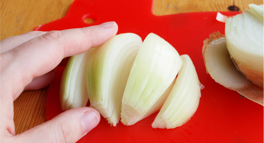 Chopping onions into wedges