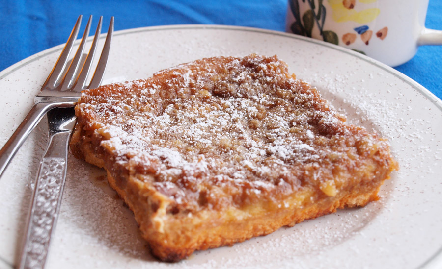 French toast topped with nuts and powdered sugar