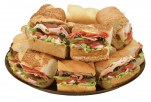 Tray of sandwiches on a variety of bread